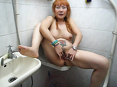 Mature Asian woman takes a piss