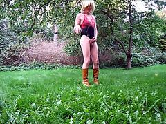 Flexible crossdresser pees in his garden