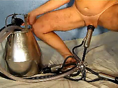 Milking machine fixed to his cock and sucking