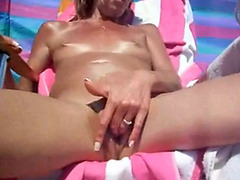 Sweet pussy gets some fingers under the sun