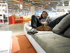 Lady pees on the sofa in the furniture shop