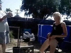 Blonde bitch urinates in the yard