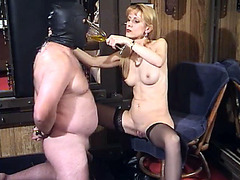 Skinny MILF pisses in the glass and treats her male slave