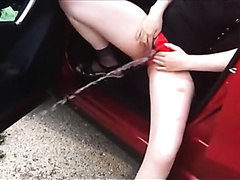 Pissing From Red Car