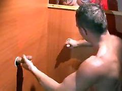 Muscular guy filmed at gloryhole