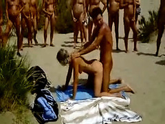 Wild doggystyle bonking at the nudist beach