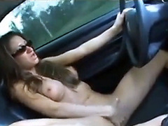 She masturbates vigorously driving her car