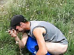 Hot dude smokes and takes a dump in a field