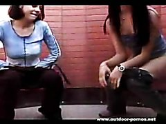 Two girls pissing outside