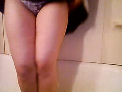 Girl peeing her skirt