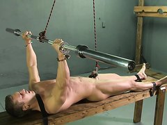muscled guy have his balls tortured