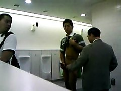 Asian guy wanks in the public toilet