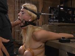 Kinky bondage on slut gagging on dick
