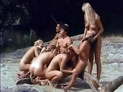 Outdoor nudist orgy by raging river