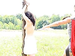 Naked woman on the whipping post-Myriam