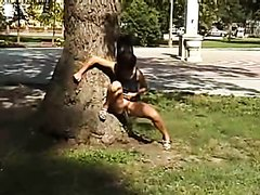 public piss while against a tree
