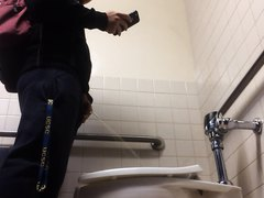 student pissing & texting