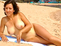 Busty Russian babe goes skinny dipping on the beach