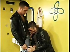 Leather clad guys fuck in toilets