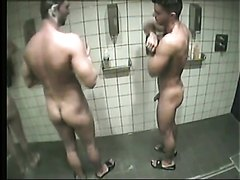Shower in the gym with some great bromance going on