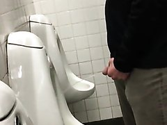 Young guy pissing during a ball game