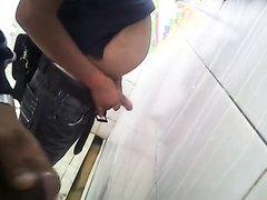 Chubby guys at the urinal having fun