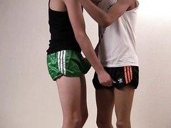 Teenboys in shiny adidas shorts