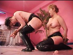 Busty mature woman teaches a slim girl to empty bowels
