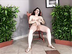 Mature woman plays and pisses