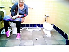 Nice fart from a Latina woman peeing in the public toilet