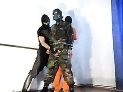 Soldier and Prisoner Cock Whipping