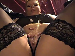 Short haired MILF in sexy lingerie pisses on herself