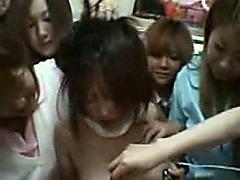 Busty Japanese schoolgirl in a lesbian gangbang
