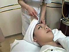 Desirable doll enjoys a lesbian massage