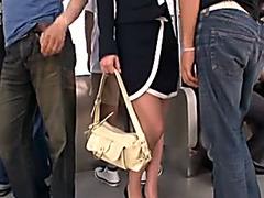 Japanese chick slurps hard dicks in a train