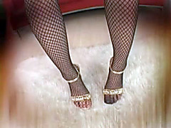 Eastern beauty in fishnet stockings rides a big cock