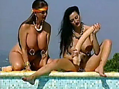 Pierced retro ladies are playing with their giant dildo