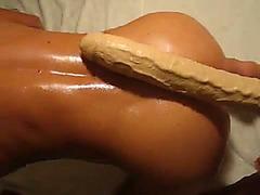 Giant dildo entering his butthole