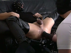 Lustful dude pushing fist into ass of his friend