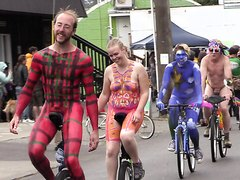 Colorful body painted nude bikeriders