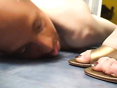 Slave man worships to a mistress and licks her shoe