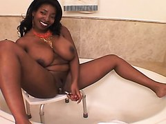 Black goddess talks dirty and takes a sexy piss