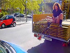 Obscene German babe peeing from the back of a truck