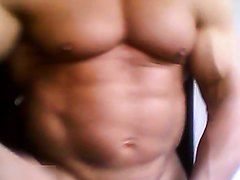 Bodybuilder spreads his cheeks