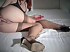 Lingerie beauty fists her asshole in webcam show