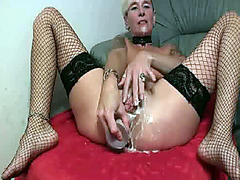 Huge black dildo up her ass makes her moan