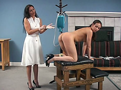 Young brunette receives an enema and a spanking