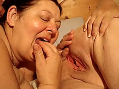 Fat woman fingers lesbian pussy and sucks a dick