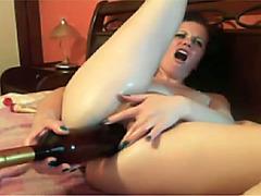 Webcam amateur stretches asshole with wine bottle