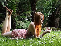 Redhead beauty in sundress masturbates wet pussy outdoors